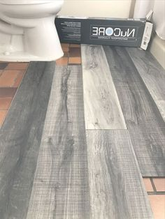 Vinyl plank flooring that& waterproof. Lays right on top of your existing floor. Love this col Vinyl plank flooring that& waterproof. Lays right on top of your existing floor. Love this col Future House, My House, Basement Remodeling, Bathroom Remodeling, Cheap Remodeling Ideas, Cheap Bathroom Remodel, Tub Remodel, Bathroom Makeovers, Budget Bathroom