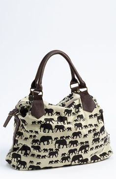 Free shipping and returns on Amici Accessories Elephant Print Canvas Shoulder Bag at Nordstrom.com. A pachyderm print raises a slouchy canvas shoulder bag with faux-leather handles and details to trendy heights.