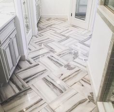 Thank you @tritonstonegroup for sharing! This eye catching bathroom floor by @katmbailey is featuring Marble Systems Skyline Polished Marble Collection ( 18x18 ). Our Skyline Marble represents variety of shades from milky snows to cool silvers. Available as tile, mosaics, water jet decos, mouldings and many more, this collection has the ability to transform any space from bland to electric! #marblefloor #modernbathroom White Mosaic Tiles, Mosaic Diy, Marble Tiles, Marble Floor, Tile Mosaics, Marble Bedroom, Travertine Tile, Bathroom Inspiration, Bathroom Ideas