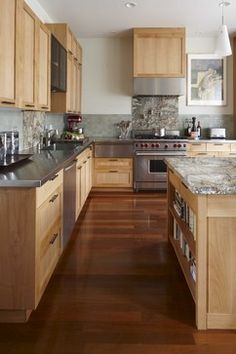 The natural cabinets look good with this floor.  Would change the counter to granite and change the pulls.