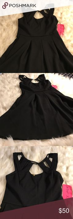 Betray Johnson Black Dress with Cutouts Cute lbd with cutouts and gold exposed back zipper. 100% polyester Betsey Johnson Dresses