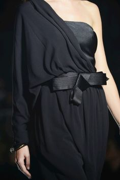 Lanvin SS 2013 This could possibly be just a long length of REALLY GOOD QUALITY black silk with ends hand hemmed (like a good scarf). Maybe a cool brooch at the wrist? Be careful that it doesn't look cheap.