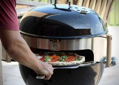 """KettlePizza: Transform Grill into Outdoor Pizza Oven: """"Pizzas need to be cooked with consistent heat, and that's exactly what the KettlePizza provides. This conversion kits works for both 18.5 and 22.5 inch kettle grills."""""""