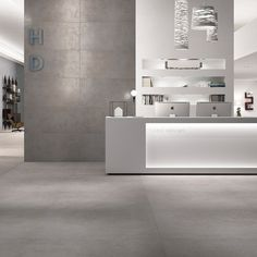 super thin porcelain tiles (think 3 mm thick -- looks like cement) by Strata Tiles