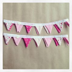 Mini bunting curtain tie backs- so cute! perhaps not so pink though