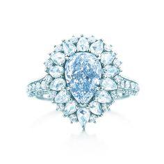 Tiffany & Co. 1.45 Carat Blue Pear Cut Diamond Surrounded In Pear & Brilliant Channel Set White Diamonds.