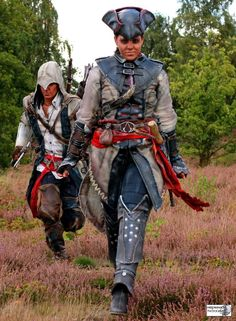 Connor and Aveline from Assassin's Creed 3 and Assassin's Creed 3: Liberation. Love the fact their costumes look worn and dirty instead pristine and clean.
