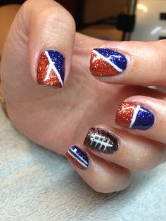 Denver Broncos nails, I would change the football to either the logo or white sparkles or something for my wedding day :)))