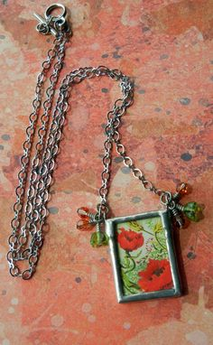 Soldered glass collage pendant by Mollie, finished with Czech glass and silver-plated chain.