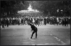 Police hurl grenade at student protesters, Boulevard Saint-Michel, Paris, 1968, by Goksin Sipahioglu
