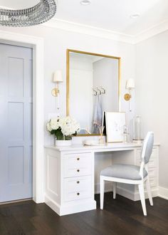 A white and gray octagon vanity chair sits at a white makeup vanity adorned with brass hardware and positioned beneath a gold framed mirror flanked by Camille Sconces. Home Decor Bedroom, Beautiful Closets, Bedroom Desk, Bedroom Vanity, Decor, Home, Interior, Bedroom Inspirations, Home Decor