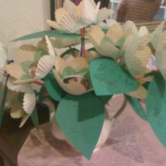 Kindergarten Teacher Appreciation Gift. Cupcake liners printed to look like flowers, straws attached for stems, green construction paper leaves that each kid wrote on, in the center of each flower is a photo of the student cut in a circle and the flowers are in a white teapot because the teacher likes tea.