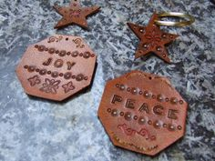 Tooled leather Christmas decorations, made from 1.4mm buffalo veg tan leather, pieces available from The Identity Store