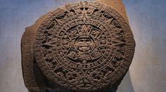 Aztec Calendar Stone -carved in 1479 -dedicated to the Sun God -3 feet thick, 12 feet across, weights 25 tones -carved from basalt(solidified lava) -reflects Aztec's understanding of time and space -center is  Tonatuih(earth god,sun) -sun required blood to remain strong, and human sacrifices were often offered.