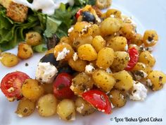 Crispy Pesto Gnocchi with Tomatoes, Black Olives and Feta Cheese