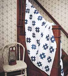 Blue and white churn dash quilt or monkey wrench