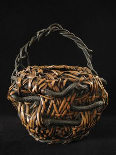 "Ikebana basket, Japan  Nemagaridake bamboo, vines  12"" wide by 15"" high  Pre-1950"