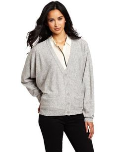 Coupe Collection Women's Abel Cardigan Coupe Collection. $35.00. Rib at the waist and sleeve with dolman sleeve and it has a regular fit and with label at the back neck. Machine Wash. Button down cardigan with side pockets and oversized sleeve. 50% Wool/28% Viscose/22% Nylon