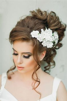 loose wavy wedding updo with white flower headpiece