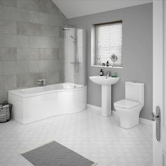 This super-smart contemporary grey bathroom design features grey patterned floor tiles, large dark grey wall tiles and a modern bathroom suite with P-shaped bath / shower. Contemporary Grey Bathrooms, Grey Bathrooms Designs, Large Bathrooms, Modern Bathroom Design, Bathroom Interior Design, Small Bathroom Suites, Contemporary Bathrooms, Contemporary Interior, Grey Wall Tiles