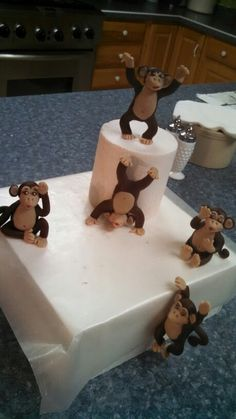 Modeling chocolate monkeys for a cake by christinascakery.com