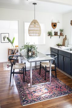 """""""The light fixture over the table and the vintage Turkish rug were the first two things I bought when I moved in so they definitely guided the design for the entire space in terms of color and the materials that I used,"""" says Ashley. """"I love them both!"""""""