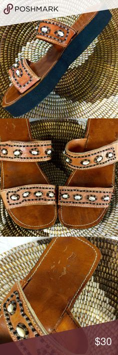 """Puka Shell Beaded Leather Slides These are so adorable, made in Ghana lightweight caramel colored leather slides with dense black foam 1.25"""" platform. Good condition see photos. There is minor scuff wear. Tagged a 7 but fits 8-8.5 . Foot bed  10.5"""" & 4"""" wide. I have a skinny foot so too wide for me...boo hoo..but maybe perfect for you! ☺️Measure your tootsies! It's a great way to buy shoes and gauge a fit!! Ask if you have any questions Shoes Sandals"""