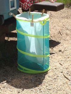 Use a collapsible hamper as a garbage can for camping. Compact, easy and no-fuss! 12 Secrets for Stress-Free Camping
