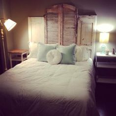 My dad and I made this headboard out of old shutters and doors I found at a junk shop.  Love it!
