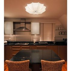 "Modern and sophisticated -- without the hard edges or plastic and metallic look of so many contemporary flush mount fixtures.    If I had to marry a light fixture, it would be this one.  I installed two at our condo.  I could not stop staring at them.   The fabric and the shape is so gorgeous - the light glows and made even the dusty, disorganized rooms ""under construction"" look better.  I  Possini Euro Planetarium Ceiling Light"