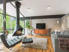 A stylish mid-century modern makeover draws nature inside