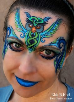 Gorgeous owl face painting with celtic knots by Ann Lyon