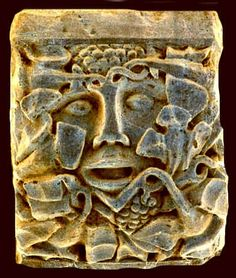 """Pinchbeck Green Man, high on the north wall at Pinchbeck. Tina Negus who took this picture says he is a """"tree nose"""" because his nose forms the trunk of a tree."""