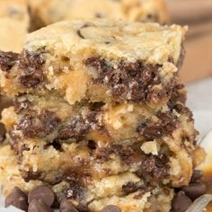 Chocolate Chip Caramel Butter Bars - easy sugar cookie bars filled with chocolate chips and caramel! These gooey bars are the perfect dessert recipe!
