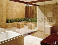 I have always wanted a bathroom where the tub is situated in front of a large glass window that showcases a garden- fenced off of course. | Bathroom Design | Wood Flooring | Contemporary Interior | Home Ideas