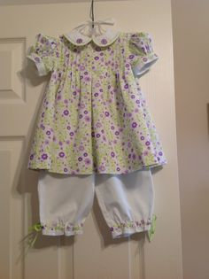 This outfit was made using The Tuck Dress pattern by Collars Etc. for the top and Parker's Pants by The Children's Corner for the bottoms.  Both pique fabrics are from Fabric Finders.  The embroidered collar and cuffs are in-the-hoop designs from Appliqué For Kids.