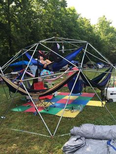 17-ft Camping Hammock Dome (3-8 people) If it rains (or too sunny), wouldn't neatly placed tarps with strong holdfasts do?