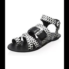Loeffler Randall Cream Black Strappy Sandal Loeffler Randall cream and black strappy leather sandal with toe ring.  Size 8 medium.  New with box.  Add some interest to your footwear collection with this strappy design, featuring cream and black polka dots.  No trades. Loeffler Randall Shoes Sandals