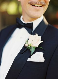 Ivory Rose Boutonniere for Groomsman | Photography: Caroline Tran. Read More: http://www.insideweddings.com/weddings/magical-garden-ceremony-tented-reception-with-chic-french-theme/733/