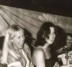Agnetha and Frida - I don't know what the background is to this photo, but they look like they're having a great time!