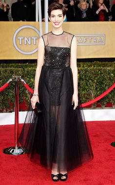 Anne Hathaway in Giambattista Valli Haute Couture- The best supporting actress winner played peek-a-boo without showing too much actual skin in her embroidered tulle gown. And who knew short hair could be so versatile? B+