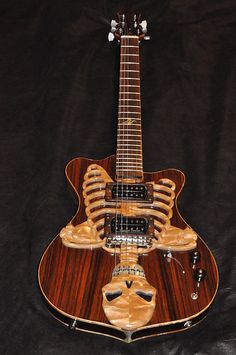 Custom semi/ hollow body style electric with a 24.5/8 scale fretboard .  Rosewood and maple body with a acoustic style hollow body design and  glued in mahogany neck with carbon fiber neck supports ,Seymour Duncan  PH1 and Pearly gates pickups wired with a 5way pickup selector,  volume/tone,a...