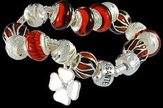 silver plated items: bracelet with snap closure, enamel beads, balls, luckyclover charm, lock. Five glass beads with 925 silver core.
