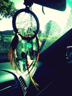 The incorrect way to utilize a dreamcatcher. Do you plan on sleeping while driving? No? Then don't put a dreamcatcher on your mirror....    Odd pet peeve of mine. =P