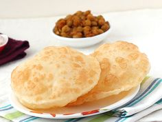 'Bhatura' is classic Indian puffed bread which is always associated and remembered with inseparable Chole Bhature. This authentic deep fried Indian bread is made with fermented dough.