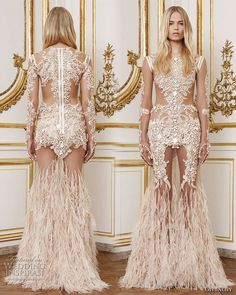 Givenchy Fall Winter 2010/2011 Haute Couture, designed by Riccardo  Tisci - Catrina: long dress in stretch nude tulle embroidered with  blush colored crystals, hand cut lace motifs and ostrich feathers