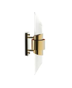 Following the creation line, the small version of Tycho Wall creates a cosmopolitan luxury environment that conveys an intimate lighting as its building inspiration and its reflection on the water. Brass with gold plated and crystal glass, ideal combination to be used with more than one piece.