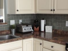 Subway tile backsplash. White kitchen.