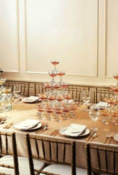 stacked-champagne-table-centerpiece - Once Wed [g> how long do the bubbles last ?]