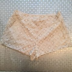Honey Punch Lace Crochet Shorts Honey Punch Cream Lace Crochet Shorts. Pockets and side zipper. Size medium. Silky lining. So so cute and adorable! Just too big on me. Only wore once (or tried too even though they were big!) Very sweet and delicate. Great condition! Honey Punch Shorts